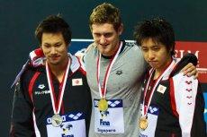 Cameron van der Burgh (w środku), złoty medalista olimpijski z Londynu. Tutaj na podium wyścigu w Singapurze.