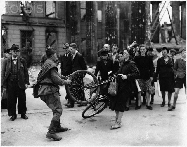 Russian Soldier Tries to Buy Bicycle from Woman in Berlin, 1945