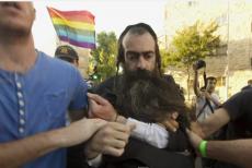 Atak nożownika - żydowskiego ortodoksa na paradzie gejów w Izraelu przez wielu uważany jest za akt terrorystyczny