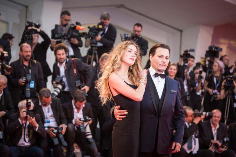 Johnny Depp z żoną Amber podczas festiwalu w Wenecji.