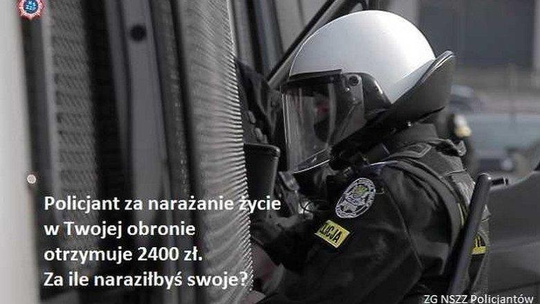 Jeden z bilbordów autorstwa NSZZ Policjantów obrazujący rażąco niskie wynagrodzenia Funkcjonariuszy.