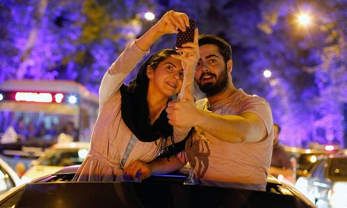 Iranians celebrate in the streets of Tehran after nuclear talks. Photograph: Abedin Taherkenareh/EPA