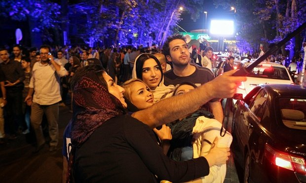 Iranians celebrate the nuclear agreement in Tehran. Photograph: Ahmad Halabisaz/Ahmad Halabisaz/Xinhua Press/Corbis