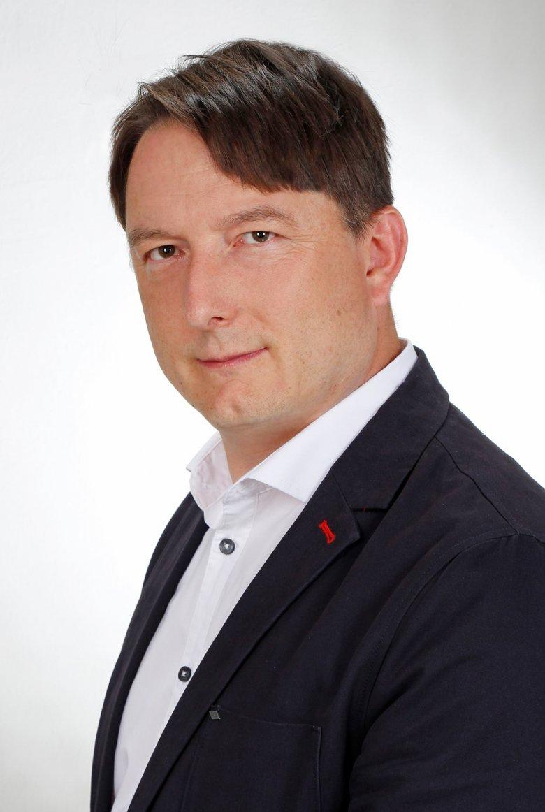 """Dariusz Kaliński - autor książki """"Bilans krzywd""""."""